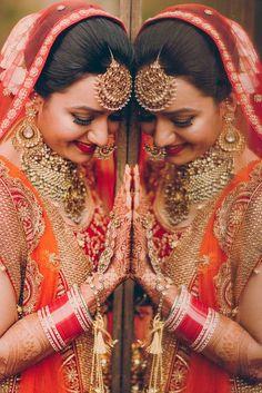 Maang tikka, choker jewellery , orange and red duoatta , bride getting ready