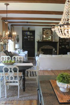 Create warmth and architectural interest in a space with AZ Faux Beams, new lighting, and creamy white paint.