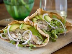 The experts at HGTV.com share an easy-to-make chicken-stuffed pitas recipe topped with tzatziki sauce.