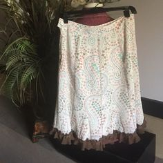 Chadwick's skirt Chadwick's collection skirtcolor is off white with brown, pinks and blue flowers and brown trim at the bottom. Size is 2P. Shell: 100% polyester and lining: 100% polyester great condition! Chadwicks Skirts