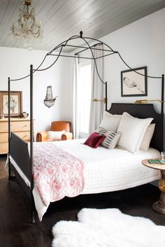 Alluring black metal canopy bed with interesting top