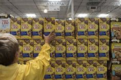Patty McCubbins shops for General Mills's Fiber One bars at a Costco  store in...