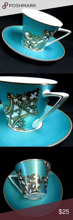 Graces Teaware Porcelain Cup & Saucer Set Teal This is an absolutely exquisite, elegant and whimsical cup and saucer set from Grace's Teaware in fantastic preowned condition -- no knicks, chips or cracks. The tea set boasts gorgeous whimsical gold and white flourishes over a vibrant metallic teal blue, with gold trim around the saucer, and teacup triangular handle.  This is the PERFECT cup and saucer for a mad tea party, eclectic and kitsch garden tea party, or just for enjoying your favorite blend from the comforts of your home. Grace's Teaware Other