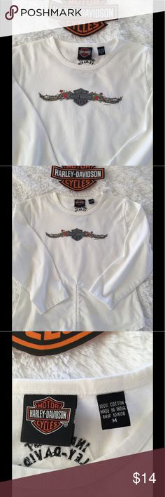 Draw String Harley Davidson Top This shirt is just cute! Bright white simple front graphic, size M, true M, has a draw string at the bottom, have a belly button piercing, perfect way to show it off! No flaws, no pet/smoke closet Harley-Davidson Tops Tees - Long Sleeve