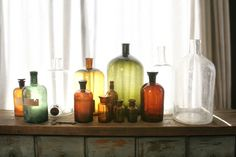 """If there's ONE thing I learned from working at a home furnishing's store, it's: Grouping """"like items"""" together in a cluster ALWAYS makes for a great statement in your home. Whether it be glass bottles, candle holders, coats hooks on a wall, etc. Seriously!"""
