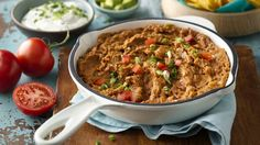 This quick and easy dip will be your family's new favorite go-to bean dip with cheesy goodness, taco meat, beans and salsa.