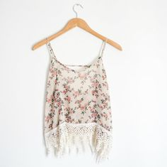 SALE: Reg. $25  Sheer floral tank top with crochet detailing on bottom and open back. Oversized/loose fit.  100% Polyester Made in USA