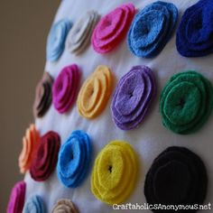 Felt flower pillow...Ooo! I love this for Spring! What a fantastic way to bring in your room's color pallette