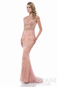 Gorgeous jewel neck pageant gown with cap sleeves, intricate baroque beaded motif along the shoulders, bodice, and column skirt. This special occasion gown features sheer illusion yoke, back, and a cutout keyhole detail at shoulders.