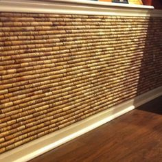 Wine Cork Wall -this would be great on the wall that Darby has her food and water bowls. And we definitely have enough corks for it