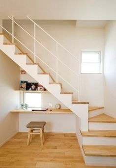 22 Under The Stairs Home Office Nooks a minimalist home office with a windowsill desk, a chair with Desk Under Stairs, Loft Stairs, House Stairs, Basement Stairs, Stairs In Kitchen, Stairs In Living Room, Office Nook, Office Decor, Modern Stairs