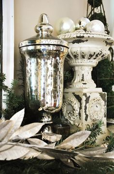 I have this exact chippy urn ! Mine has willow branches, a nest and pearls in it :) (from Sophia's Decor)