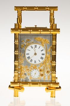 Carriage clock in gilt bamboo case