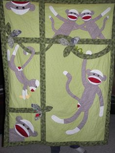 Sock Monkey Quilt, it needs 1 more monkey and it would be perfect ( i don't like the green )