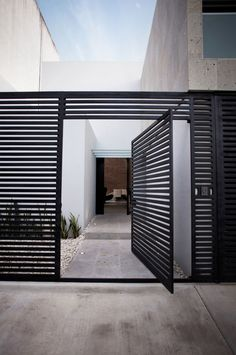 Awesome Volume House of Cereza 20 by Warm Architects in Cancun: Beautiful Cereza Home Design Exterior With Modern Welcome Gate Used Black Door Design Ideas And Concrete Flooring Style ~ SFXit Design Architecture Inspiration Front Door Design, Entrance Design, Design Entrée, House Design, Design Ideas, Design Inspiration, Design Grill, Furniture Inspiration, Architecture Details