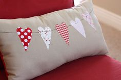 Isn't this pretty?  I love the little hearts sewn on this cute pillow!  What a great idea to coordinate with a new, finished quilt using your scraps!