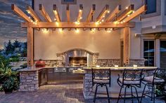 Love the overhead structure and lights...21 insanely clever design ideas for your outdoor kitchen