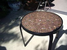 $10 DIY: $4 DIY Penny Table.  This would be awesome with all the coins we've collected from foreign countries. . . . currently stuck in a drawer.