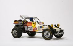 Tamiya Super Champ with an amazing paint scheme! Remote Control Cars, Radio Control, Radios, Rc Buggy, Rc Cars And Trucks, Rough Riders, Rc Model, Vinyl Toys, Cars