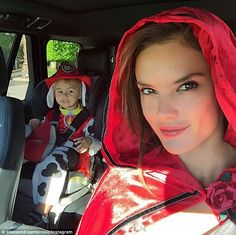 To a Halloween party we go: Alessandra Ambrosio celebrated Halloween early on Friday dressed up as a sexy Red Riding Hood while her three-year-old son Noah went as a firehouse Dalmatian dog  Her bright get-up was enhanced with a red hooded cape and there were black flats on her feet that allowed for comfortable walking. Alessandra's excited little boy went as a firehouse Dalmatian dog complete with black and white spotted jumpsuit, floppy ears, red waist coat and a firedog's all-important…