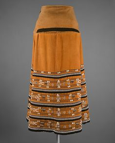 Skirt (Isikhakha or Umbhaco), 20th century, South Africa Culture: Xhosa or Mfengu peoples, Cotton, wool, glass beads, shell buttons, ochre pigment Beadwork has been a major form of aesthetic expression in southern Africa for nearly 200 years. Among the many diverse ethnic groups of the region, the Xhosa peoples have an especially rich tradition of beaded regalia. This elegant textile skirt, also known as an isikhakha or imibhaco, is one example of the incorporation of beadwork into garments. ...