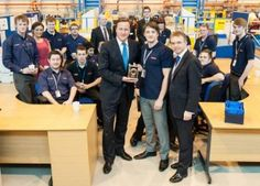 Cameron, Mark Menzies and apprentices at BAE Warton