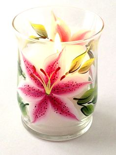 "Beautiful stargazer lilies hand-painted encircling a 4.5"" tall mini pillar candle holder which holds a 2.5"" mini pillar (included). Sealed and heat-cured for added durability."