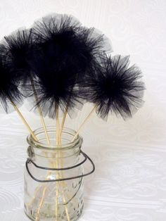 black tulle pom pom wands...There must be a need for these at the wedding...right?
