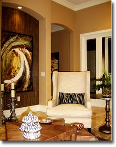 Home builder's model great room featuring a softly modern style with abstract art, designed by Clay Stephens
