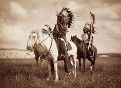 Native American Sioux Indian Chiefs on horseback. Photograph by Edward Curtis in 1905.