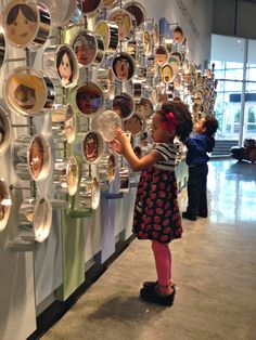 My kids at the Chicago Children's museum. I like how these spin and the shiny material on the side of the circles give off good reflection and light. The interactive quality is great too.