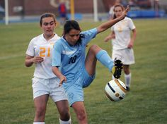 Stephanie Mendez traps a ball in front of the Riders' Jordan Willey in the Vikings' 6-0 loss to Caesar Rodney. Click soccer photo to read entire sports article: Cape soccer falls to Caesar Rodney 6-0