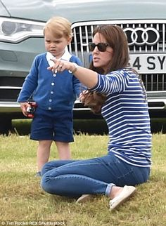 Kate laughed and joked around with George, at one point even teaching him how to kick a ball 14 June 2015.