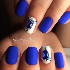 The Matte Blue Nail Art Design. This matte-y blue and white nail art with the Royal blue studs is definitely an inspiration.