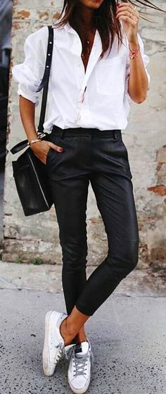 #spring #outfits  photo of woman wearing white dress shirt and black pants. Pic by @streetstyle__outfits