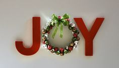 Joy spelled with a beautiful Christmas wreath!