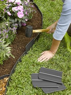 This is the quickest, easiest system you'll find for defining an edge between your lawn and flower beds or garden. Simply pound each interlocking piece into the ground with a rubber mallet; in most soils there's no need for cutting, trenching or tearing up sod. To turn a corner, just bend the sections to form the angle you need. | Gardeners.com