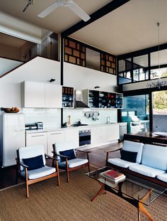 Terrific space. I really like the open kitchen, the height, and the Danish modern living room set.