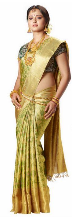 South Indian bride. Temple jewelry. Jhumkis.Gold silk kanchipuram sari.Braid with fresh jasmine flowers. Tamil bride. Telugu bride. Kannada bride. Hindu bride. Malayalee bride.Kerala bride.South Indian wedding.Anushka Shetty.