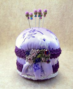 Petite French Violet lavender satin purple braid pincushion with Victorian focal and decorative straight pins vintage look sewing room TAGT. $13.00, via Etsy.