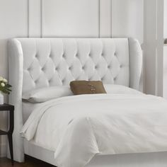 Tufted Wingback Velvet Upholstered Headboard - A stylish addition to your bedroom decor, the Tufted Wingback Upholstered Headboard features plush padding and traditional tufting. This upholstered...