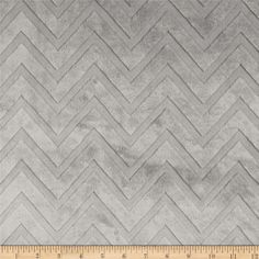 """Shannon Minky Cuddle Embossed Chevron Silver from @fabricdotcom  This soft and cuddly fabric features an embossed chevron design. A two-tone color is depicted by the embossed design. The fabric is dyed a solid color with a """"high/low"""" pile. The design runs the width of the fabric, has a 5 mm pile, 450 grams, and is perfect for baby accessories, blankets, throws, pillows and stuffed animals."""