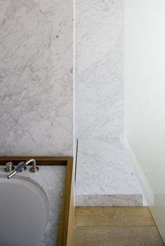 Marble bath by Vincent van Duysen. Carrara marble shower slab. Arne Jacobsen vola tap ware.