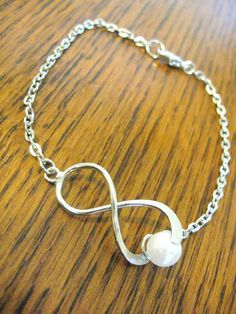 Infinity Pearl Bracelet Charm - but instead of pearl an aquamarine bead to represent my fiance's birth month and to be my something blue