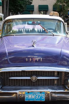 Purple Buick Taxi parked in front of the Hotel Nacional, Havana, Cuba.  Photo: abaesel via Flickr.