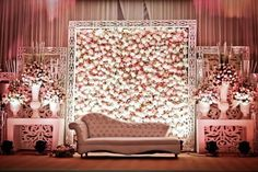 Indian Wedding decor |  bride and groom's sofa | stage backdrop in pastel pink and white flowers in a huge white wooden frame  | Stage decor ideas for indian engagement | pastel wedding decor | English style decor ideas | wedding love seat | Every Indian bride's Fav. Wedding E-magazine to read | Witty Vows shares things no one tells brides, covers real weddings, ideas, inspirations, design trends and the right vendors, candid photographers