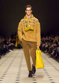 Hues of camel and sepia framed by saffron yellow accessories and eyewear from The Scholar Collection
