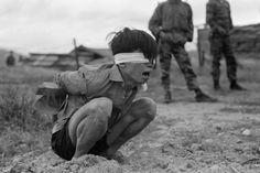 A Viet Cong prisoner awaits interrogation at the Special Forces Detachment in Thuong Duc, Vietnam, km west of Da Nang), 23 January (AFP PHOTO/National Archives) Vietnam War Photos, Vietnam Image, North Vietnam, Rare Images, War Photography, Prisoners Of War, Us Marines, National Archives, American War