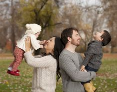 Mom and dad playing with their children in the park for a special fall family shoot by Emerald Photography | Two Bright Lights :: Blog