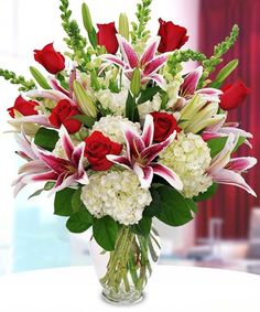 Surprise them this Valentine's Day with an exquisite design featuring fragrant stargazer lilies beautiful red roses and soft white hydrangea. http://ift.tt/2kndMg3!   #MarcoIslandFlorist #ValentinesDay - http://ift.tt/1HQJd81